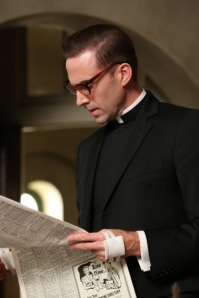 AMERICAN HORROR STORY Spilt Milk -- Episode 211 (Airs Wednesday, January 9, 10:00 pm e/p) -- Pictured: Joseph Fiennes as Monsignor Timothy Howard -- CR: Byron Cohen/FX